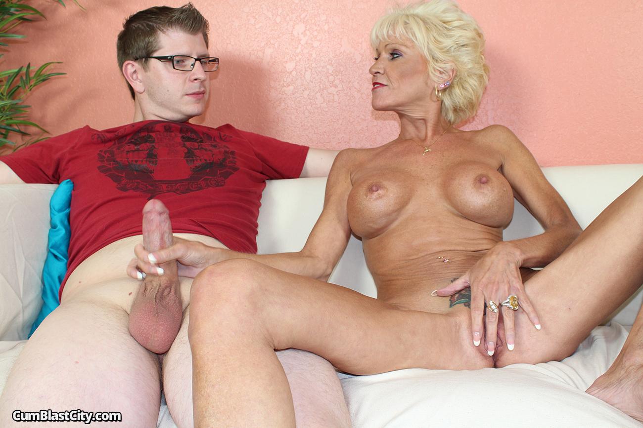 image Blonde bimbo jerks off a big dick