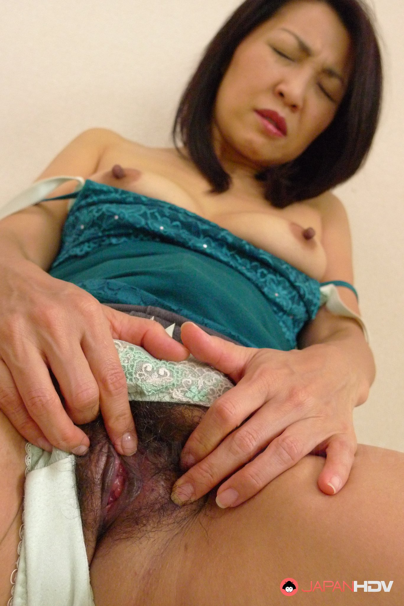 image Horny thick asian teases and stretches her tight pussy