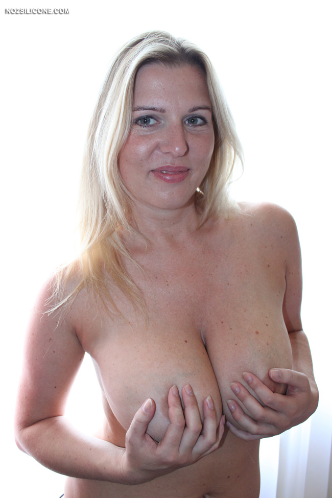 Mature milf rider on a dildo shaking with huge tits 7