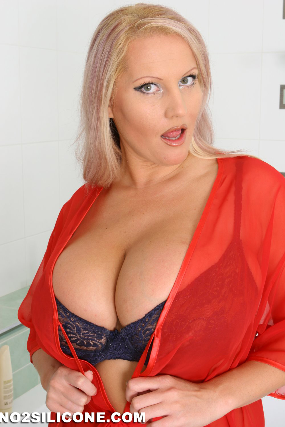 Hot busty blonde oils up amp toys