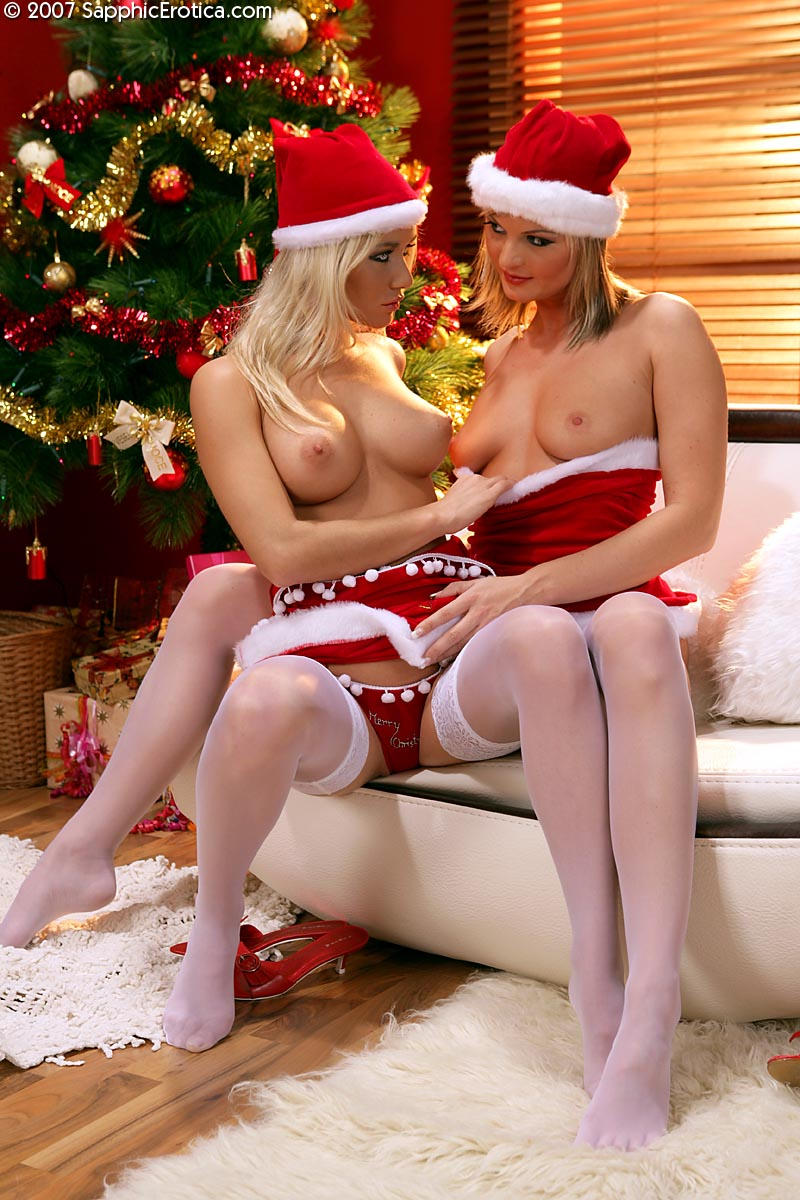 image Sexy christmas elf sits on santa039s face