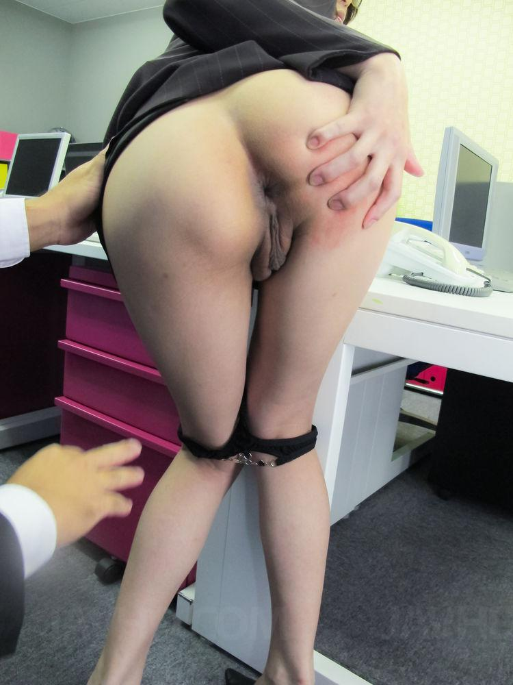 Naughty secretary over desk