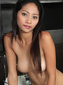 Nude girl standing sideways